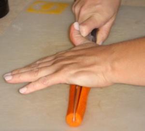 Cutting carrot in half